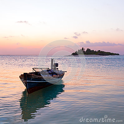 Romantic Tropical Sunset and Vintage Boat