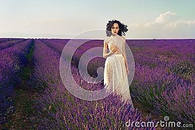 Romantic woman in fairy lavender fields
