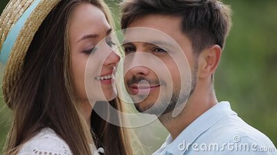 Romantic Woman Kissing Man In Cheek In Nature stock video footage