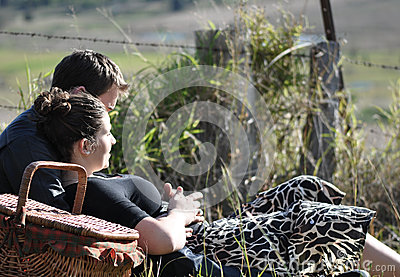 Romantic young couple having picnic in countryside