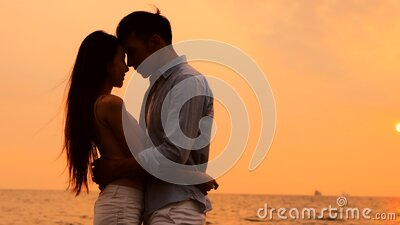 Romantic young Couple hug on the beach at sunset stock video footage
