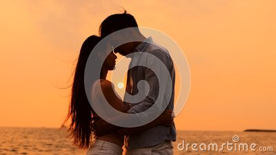 Romantic young Couple hug on the beach at sunset stock video