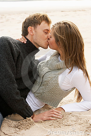 Romantic Young Couple Kissing On Beach