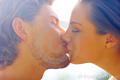 Romantic young couple kissing with eyes closed