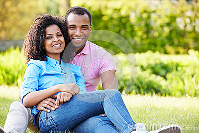 Romantic Young Couple Sitting In Garden Stock Photo