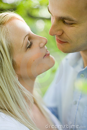 Romantic young couple about to kiss.