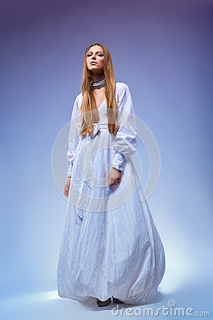 Romantic young woman in gown dress. Retro style