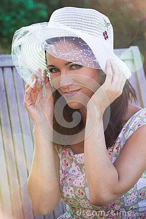 Romantic young woman in spring park