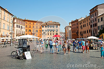 ROME-AUGUST 8: Group of tourists on Piazza Navona on August 8, 2013 in Rome. Editorial Image