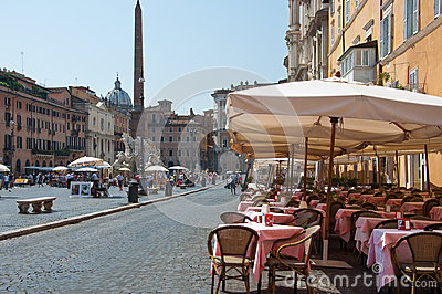 ROME-AUGUST 8: Restaurant on the Piazza Navona on August 8, 2013 in Rome. Editorial Photo