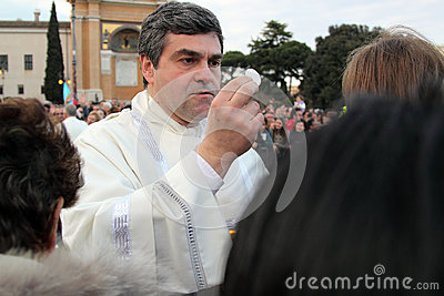 Communion during the settlement of Pope Francis, St John, Rome Editorial Photo