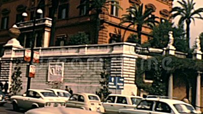 Embassy of united states of Rome. Rome, Italy - Circa 1970: the historical palace of the actual embassy of the United States of America in Vittorio Veneto street stock footage