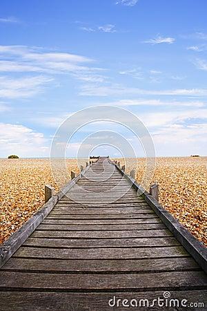 Romney för pebble för strandboardwalkmarsh