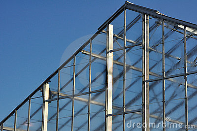 Roof of Greenhouse Against Blue Sky