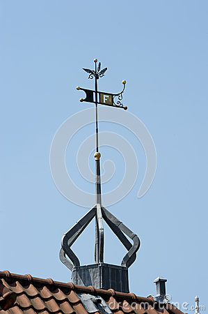 Roof top with decorated weather vane