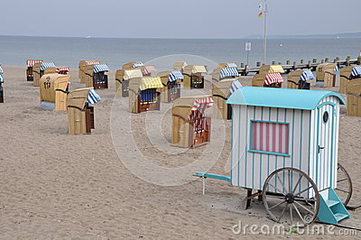 Roofed wicker beach chairs