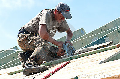 Roofer with Electric Saw