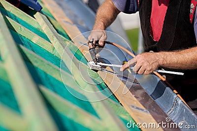 Roofer welding the gutter