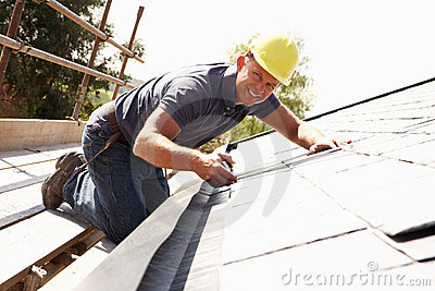 Roofer Working On Exterior