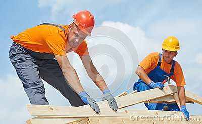 Roofers carpenters works on roof