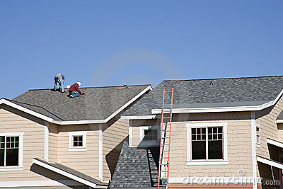 Roofers working on new roof