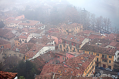 Roofs covered with fog in Verona