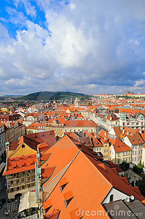 Rooftops of Old Prague under scenic sky