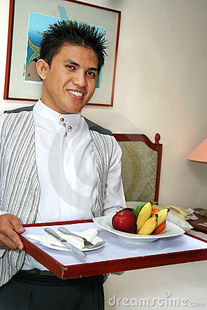 Room service staff bringing fruit