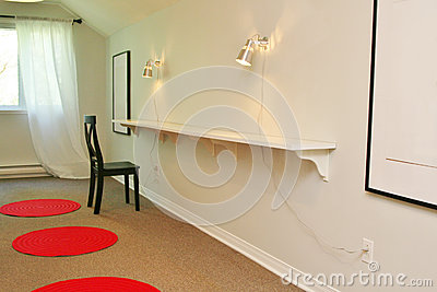 Room with shelving and red carpets