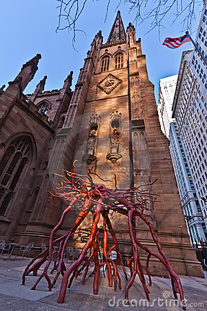 Root Sculpture and Trinity Church in New York City Editorial Image