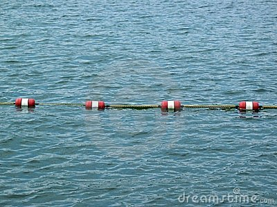 Rope barrier in sea or lake