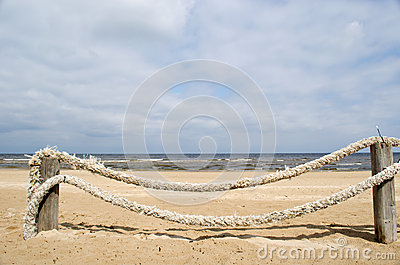 Rope log fence beach sand