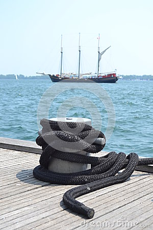 Rope and ship on water