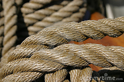 Rope tied around wooden cleat (extreme closeup)