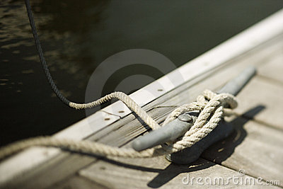 Rope tied to cleat on dock