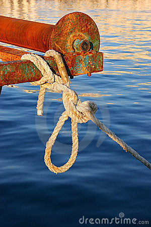 Rope tied to rusty old boat