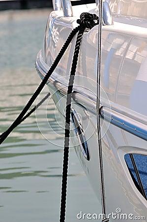 Rope of yacht stop in quiet harbor