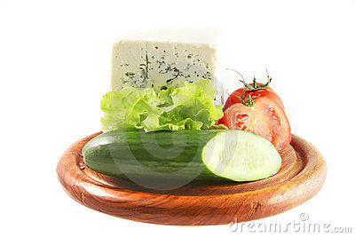 Roquefort and vegetables on wooden plate