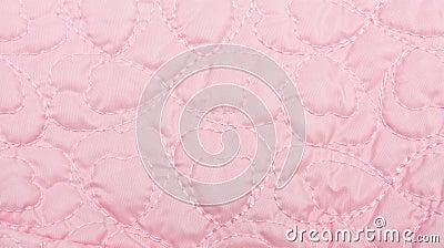 Rosafarbener Steppdeckehintergrund