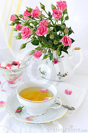 Rose bouquet and cup of tea