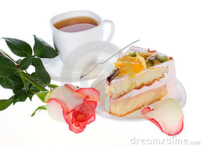 Rose cake with fruits and cup of tea