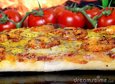 Rose colored garden prawns in wine marinade on tomato pizza