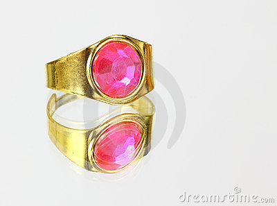 Rose colored ring on mirrored surface