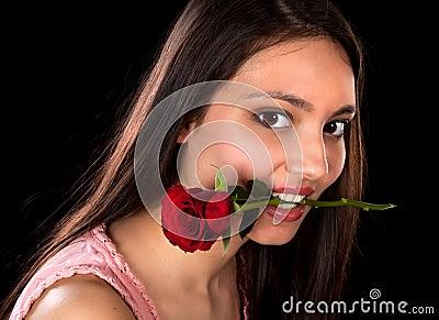 Rose between her teeth