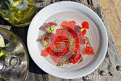 Rose petals in bowl of water