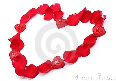 Rose petals and candles forming heart shape