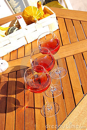 Rose wine on the wood table