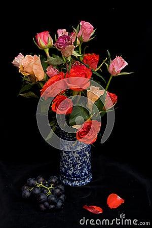 Roses in a blue vase.
