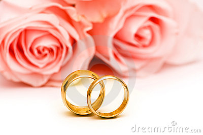 Roses and wedding ring isolated