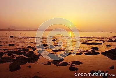 The rosy seaside sunrise in Sanya